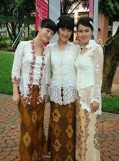 Indonesian women in white kebayas. Kebaya is the traditional Indonesian outfit. It's a body hugging top with batik wrapped below. Sensual, yet elegant.