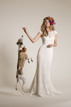 Venice lace wedding dress. Fabricated in a 1960's inspired Flower Power pattern, Babe is figure flattering with a dramatic hourglass silhouette. The…