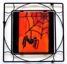 Fused glass Halloween spider in web