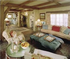 The Holiday movie cottage living room .... this was the cottage in England's set for the movie 'The Holiday' I ADORED the set! I love in this photo how you can see from the living room to the entrance all the way through to the kitchen! and those beams on the ceiling are beautiful!