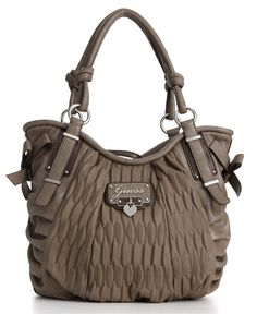 Cute Guess handbag perfect for travel if it has a zipper.