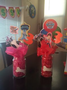 Glue sticker cutouts from nick jr on skewers and place in a cup or glass jar filled with colored tissue paper. Easy centerpieces!
