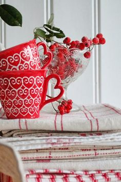 Rosy Red Cottage with vintage linens. Love the heart-shaped handles on the mugs.