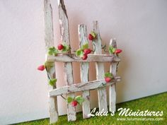 shabbychic fence or trellis with strawberry vines