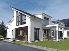 Haus AH Offenburg • Einfamilienhaus von WeberHaus •  Schickes Fertighaus mit großzügigen Fensterflächen, weitläufigem Wohn-Essbereich und offen gestalteter Küche.