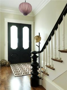 LOVE the black doors and in particular, the black banister/newel post. Black Stair Railing, Stair Banister, Black Stairs, Banisters, Painted Banister, Wood Railing, White Banister, Banister Ideas, Modern Railing