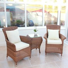 Tea for two rattan table and chairs set.  http://www.worldstores.co.uk/p/Panama_Tea_For_Two_Set_in_Java_Honey.htm#