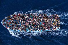 Migrants on a boat near the Libyan coast