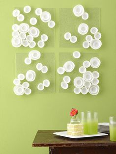 Fun Wall art, DYI peices of glass or plexiglass and glue cupcake cups on them. Possibly spray paint the cupcake cups, change their size by opening them up bigger