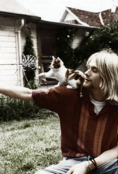 Kurt and his kitty. Taken by Tracy. Never seen this in color! x  << ALASKA:// This photograph was actually taken by Mary Lou Lord. :/