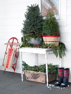 Place mini evergreens in a galvanized tub and an orchard basket, then arranged clippings and pinecones on the table and in the old crate below.