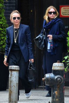 In the navy! Mary-Kate and Ashley Olsen rocked similar styles as they stepped out together...