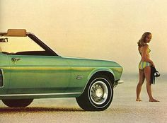 Vintage Ford Mustang ad, ca. 1960s. light pea green mustang. girl in bikini. beach.