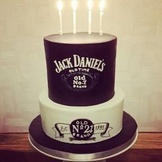 Jack Daniel's 21st birthday cake. Black and white. Bourbon whiskey and chocolate flavour. Check out my page on Facebook-Emily Spillman Cakes or email me at emilyspillmancakes@gmail.com for a quote :-) x