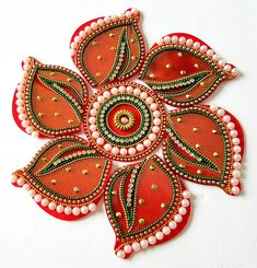 This is a 7 piece mini rangoli. Great for return gifts. Size 6 inches diameter.