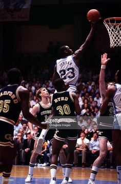 Michael Jordan #23 of the North Carolina Tar Heels goes in for the lay-up against the GeorgiaTech Yellow Jackets at Dean E. Smith Center in Chapel Hill, North Carolina, circa 1982-84.