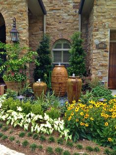 Charming Water Fountains for Landscape Decorating Ideas: Front Yard Landscape Design With Shrubs And Flower Garden Also Gravel With Trees And Water Fountains Plus Stone Siding And Arched Windows With Exterior Lighting ~ parsegallery.com Exterior Design Inspiration