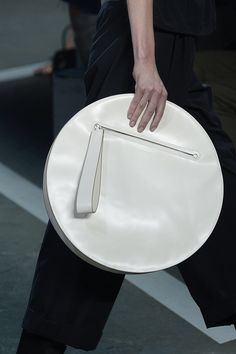 TREND: CIRCLE BAG - The new shape of things! Round handheld clutches & crossbody styles are cropping up for Spring. Marc by Marc Jacobs   Spring 2015 RTW