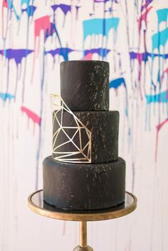Who said your wedding cake has to be white? You can choose whichever color you want your cake to be. Here a modern, edgy black cake design every bride should consider.