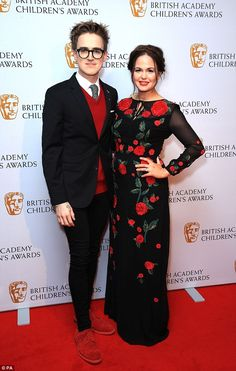 Glam getup: Looking in perfect harmony was McFly star Tom Fletcher and his stunning author...
