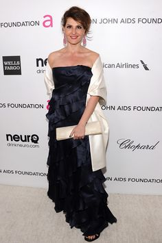 Actress Nia Vardalos carries Daniel Swarovski's champagne satin and crystal envelope Fan clutch at the Elton John AIDS Foundation Academy Awards party at the Pacific Design Center in West Hollywood on Feb. 24, 2013. || Jamie McCarthy / Getty Images for EJAF