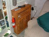 Some AMAZING RV modifications – including this one using a narrow above toilet cabinet used as an end table