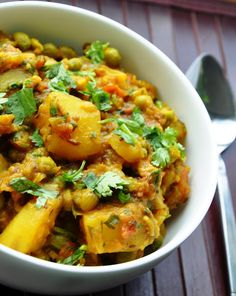 Aloo Matar - potatoes and peas cooked in a tomato sauce with Indian seasonings... what's there not to like???
