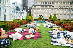 David Stark Designs set up the rooftop garden as a picnic using Adam Lippes blankets, pillows and travel bags, and also added woven baskets and charcuterie platters.  Photo: Courtesy of LaForce & Stevens