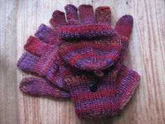 Free pattern.  Knit fingerless gloves with half-fingers and mitten tops.  Flip top mittens by candigirl1453, via Flickr
