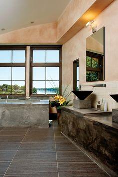 The master bath's porcelain floor tile exudes a warm wood-grain look.