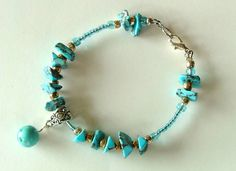 Turquoise Chip and Ball Bracelet is made of one round semi precious turquoise dyed Howlite bead hung on a strand of semi precious turquoise dyed Howlite chip beads with silver plated glass seed beads and turquoise colored glass beads. Finished with a silver colored lobster clasp.