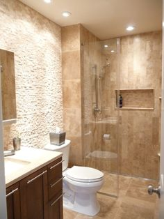 This tranquil space combines travertine in multiple tile sizes and textures to create interest.