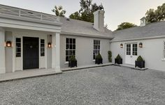 Gwyneth and Chris's new LA home. The side entrance to the mansion is set against a white paved drive