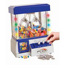 The Claw Candy Toy Grabber Machine w/ LED Lights. Use the controls to move the grabbing mechanism back and forth, right and left, up and down! Fill with candy, gum or small toys for hours of fun. Recommended for ages 8 and up