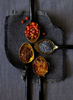 spoons with raw food & spices - food style