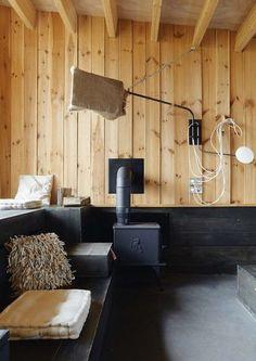 Jeu de dissimulation à l'intérieur de cette cabane de bois - Une auberge façon cabane - CôtéMaison.fr