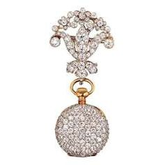 Tiffany & Co. Yellow Gold and Diamond Pendant Watch on Platinum and Diamond Pin | From a unique collection of vintage pocket watches at https://www.1stdibs.com/jewelry/watches/pocket-watches/