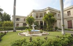 The U.S. ambassador's 1941 neoclassical-style residence was designed by architects Paul Franz Jaquet, Leland W. King Jr., and Frederick Larkin. The curved entrance of the 65-room mansion incorporates a porte cochere topped with a broad balcony. The last American ambassador departed Havana in 1961, and today the building is home to the Chief of the Mission of the U.S. Interests Section in Havana.