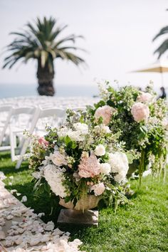 Floral Arrangements at Ceremony Entrance    Photography: Heather Kincaid   Read More:  http://www.insideweddings.com/weddings/international-couple-weds-in-floral-ceremony-with-ocean-views/847/
