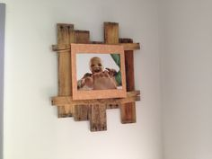 Easy DIY rustic pallet picture frame. Cut pallet boards in half, break one down the middle. Stagger the boards and nail together with the broken pieces. Don't hammer top row of nails all the way down. Glue picture to piece of cardboard, then press the cardboard down onto top row of nails that aren't pounded in all the way. Hang and enjoy :)