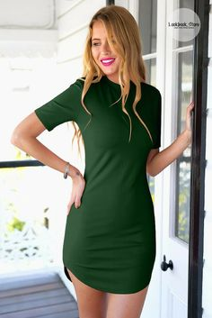 Let's Celebrate // Flaunt your curves and parade your pins in this dark green curved-hem bodycon dress.