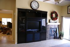 Completed custom entertainment center with shaker pillars (to hide ...