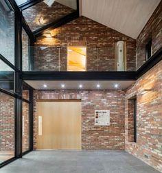 1층 선룸: 건축사사무소 모도건축의  거실