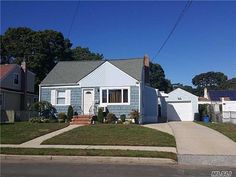 Charming Expanded And Extended Cape in Copiague New YorkThis Lovely Home Offers Formal living room and large Extended Eat in kitchen. Room for the whole family with 4 Bedrooms & 2 Full Baths. Also includes Full Basement With Family Room & Utility Laundry Room. Hardwood Floors, New Carpet, Updated Bath. Nestled On Fenced 60 by 100 Property With Detached Garage. Only a 50 minute commute to New York City by the long island rail road. 13 Month Home Warranty Available With Purchase. Contact us…