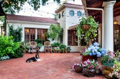 With Bistro Lights, Tiered Fountains, And Hedges And Vines, This Patio  Easily Feels Like A Private Retreat In Tuscany. Brick Paths Wind Across The  Yard, ...
