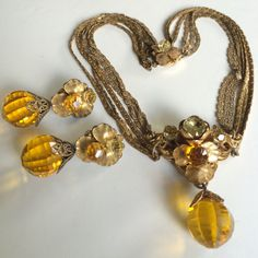 Here is a stunning vintage necklace and earrings set by designer Miriam Haskell. This jewelry is a wonderful and rare find since the earrings