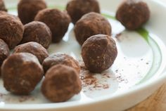 Cocoa-Oat Truffles | Whole Foods Market  1 cup rolled oats  1 cup finely chopped pitted dates  1/4 cup unsweetened cocoa powder, divided  1/2 cup almond butter  2 teaspoons pure vanilla extract  pinch ground nutmeg  pinch ground cinnamon