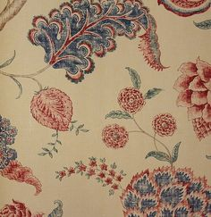 Palampore Fabric A large printed floral Jacobean design in blue and red on a dark sand cloth.