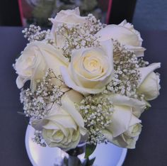 White rose and babys breath bouquet clean sleek and simple