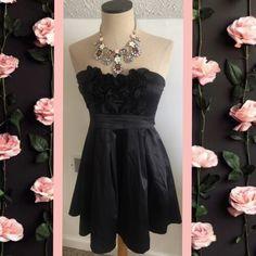 Black strapless mini dress sz M ties in back Black strapless mini dress sz M ties in back Have & Have Dresses Strapless